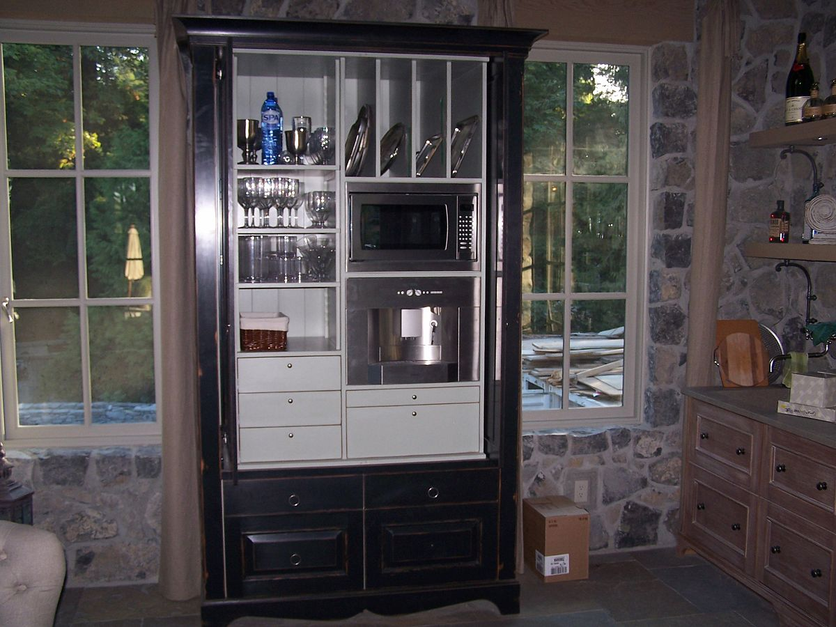 cabinet opened to show integrated appliances